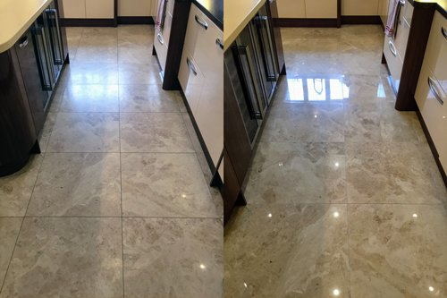 Kitchen in Cardiff with polished marble floor