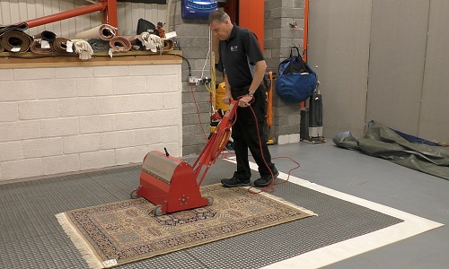 Kevin using a rug badger machine