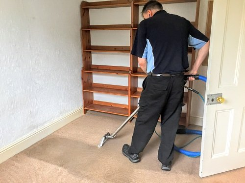 Kevin cleaning carpets in Caerphilly town