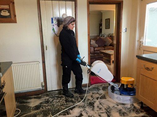 Mair cleaning a slate floor with a Klindex Rocky machine