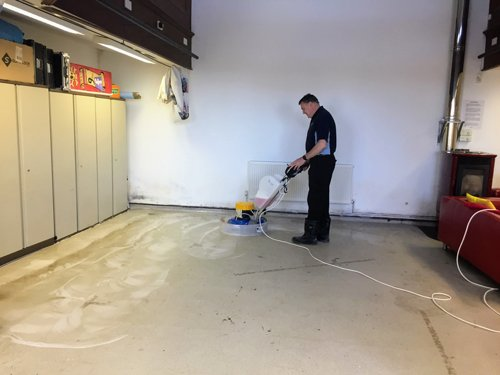 Kevin cleaning white Altro flooring with a Klindex Rocky
