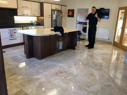 Kevin standing on a Marble floor in a Kitchen