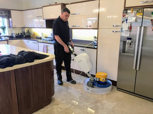 Kevin polishing a Queen beige Marble floor