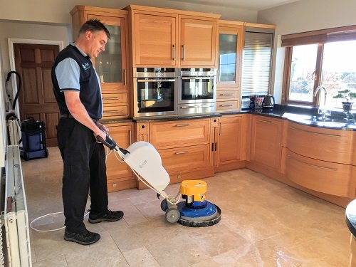 Kevin cleaning a hard floor in South Wales